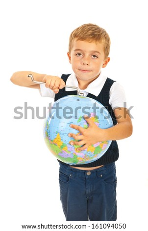 Little boy holding tool key and fixing world globe isolated on white background