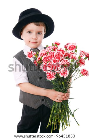 Little boy holds a bouquet of pink carnations, isolated on white