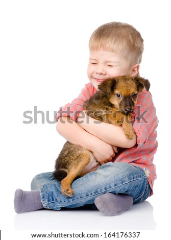 little boy hugging a dog. isolated on white background