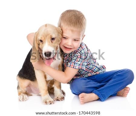 little boy hugging beagle puppy. isolated on white background - stock photo