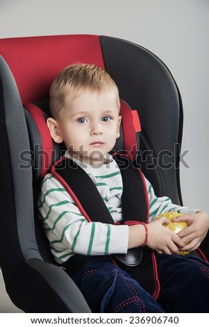 little boy in a a car seat - stock photo