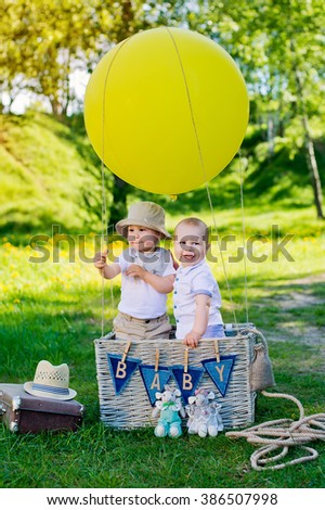 little boy in a basket with  balloon - stock photo
