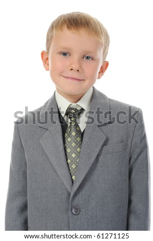 Little boy in a business suit. Isolated on white