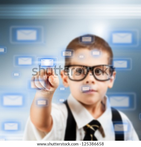 Little boy in a business suit pushing email icon on touch screen interface - stock photo