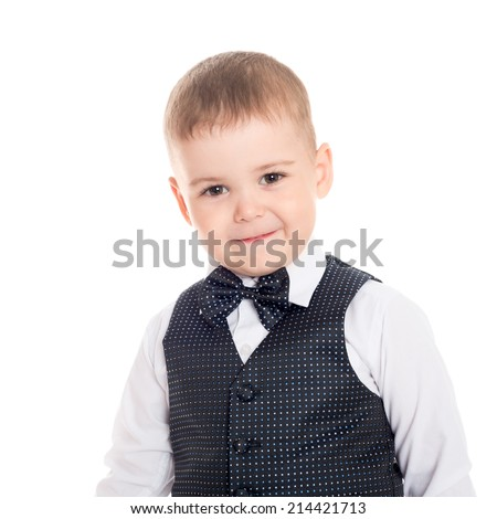 Little boy in a business suit with a bow tie.