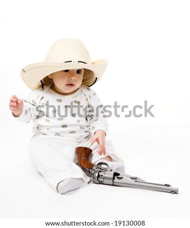 Little boy in a cowboy hat with a revolver on a white background