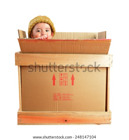 Little boy in a delivery package. - stock photo