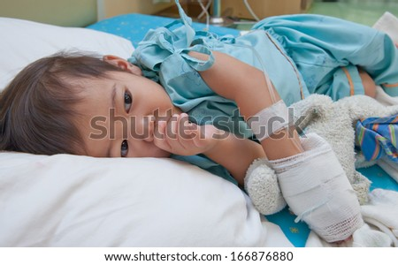 Little Boy in a Hospital Bed  - stock photo