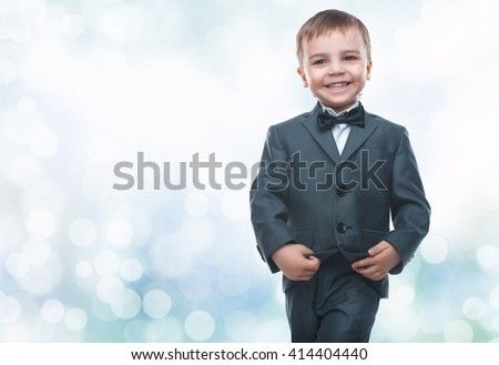 Little boy in a nice suit and glasses. Back to school. Children portrait. Stylish man in fashionable suit - stock photo
