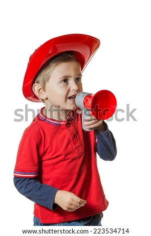 Little boy in a red helmet with a horn of fire in his hands shouting isolated on white background - stock photo