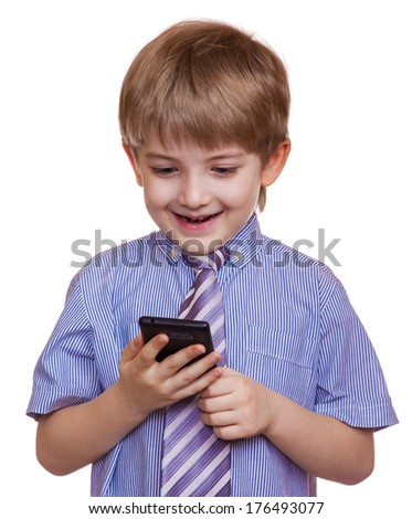 little boy in a shirt looks on the phone and smiling. Isolated on white background