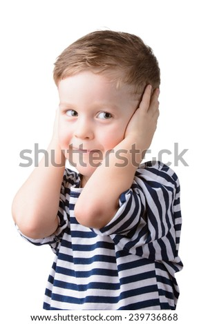 little boy in a striped vest with closed ears on a white background