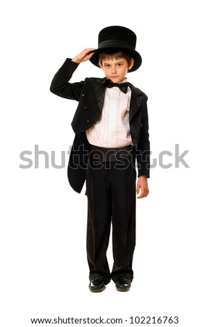 Little boy in a tuxedo and hat. Isolated