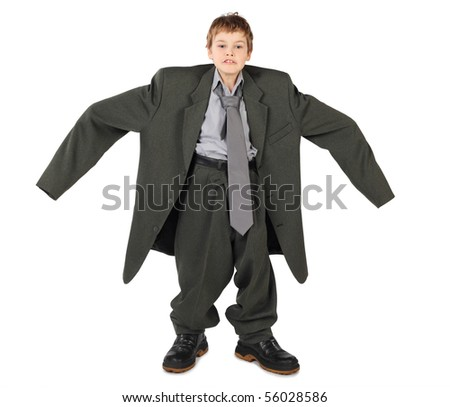 little boy in big grey man's suit and boots hands at sides isolated on white background - stock photo