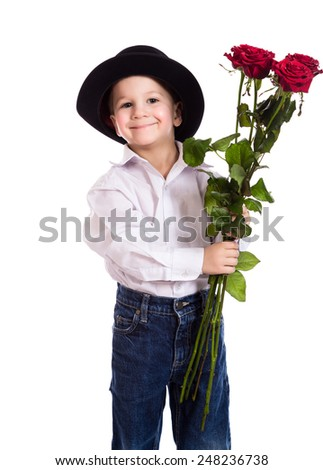 Little boy in black hat with bouquet of red roses, isolated on white - stock photo