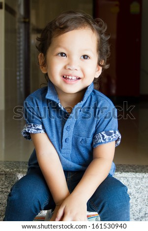 Little boy in blue shirt smiling