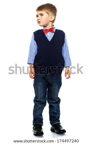 Little boy in blue vest with red bow tie isolated on white background  - stock photo
