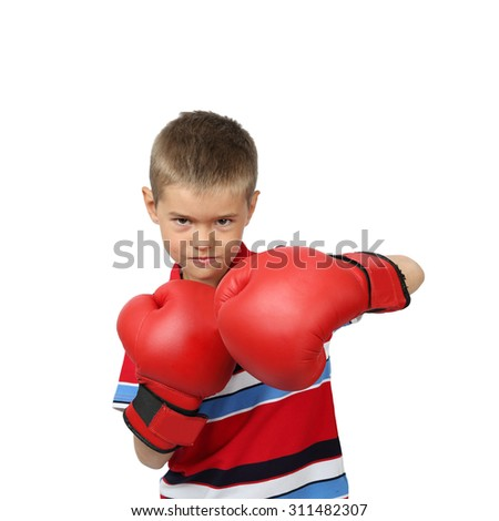 Little boy in boxing gloves with harsh facial expression isolated on square white background
