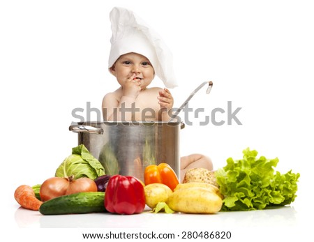 Little boy in chef's hat sitting in large casserole over white - stock photo