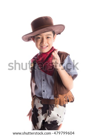 Little boy in cowboy costume on white background