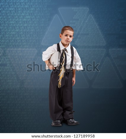Little boy in daddy business suit standing against modern virtual technology background - stock photo