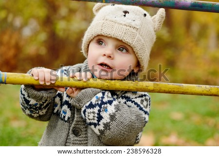 little boy in fall time walking on the street - stock photo