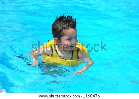Little boy in family pool - stock photo