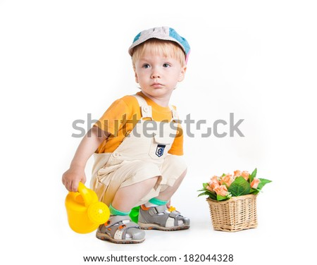 Little boy in gardener uniform sitting on white background