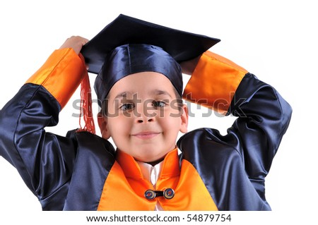 Little boy in gown holding his cap. - stock photo
