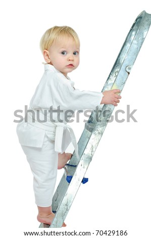 little boy in kimono on step ladder and white background - stock photo