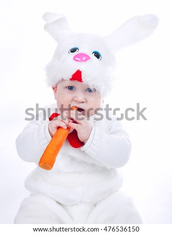 little boy in rabbit costume with carrot isolated