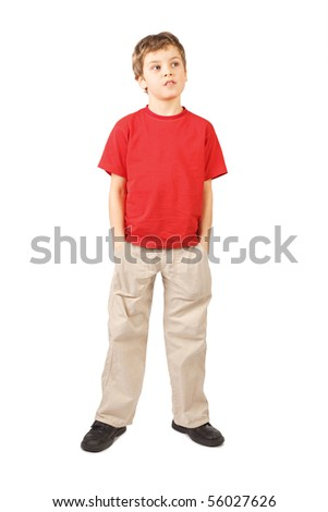 little boy in red shirt hands in pockets open mouth standing on white background