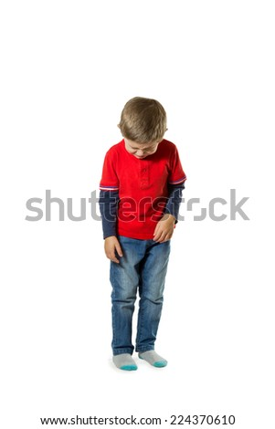 Little boy in red sweater and jeans standing lowered his head and crying isolated on white background - stock photo