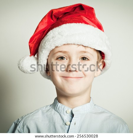 Little boy in Santa Claus hat  - stock photo