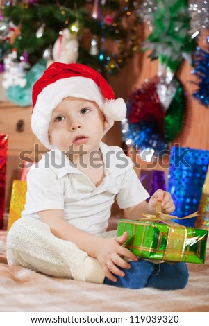 Little boy in Santa hat during Christmas - stock photo