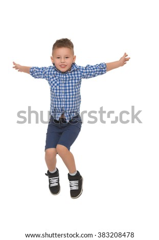 Little boy in shirt and shorts jumps spread wide his arms - Isolated on white background
