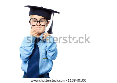 Little boy in spectacles and academic hat standing over white background. Isolated. - stock photo