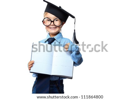 Little boy in spectacles and suit standing with opened diary. Isolated over white background. - stock photo