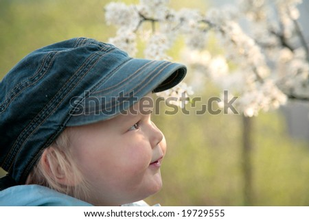 little boy in spring garden smiling