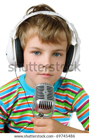 Little boy in striped shirt and headphone with microphone in hands - stock photo