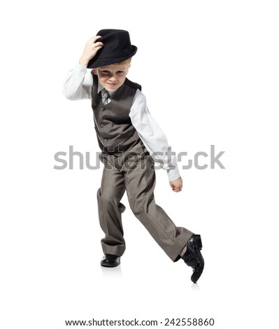 Little boy in suit and hat is dancing, isolated on white. Little boy, who is looked as businessman, is dancing on white background. - stock photo