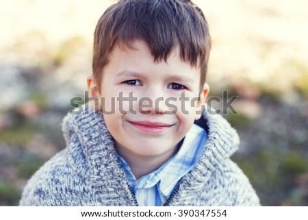 Little boy in sweater, outdoor portrait - stock photo
