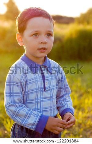 little boy in the meadow