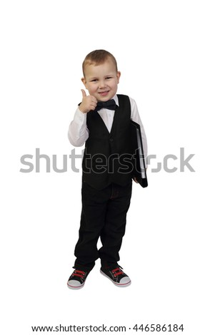 Little boy in white shirt and black butterfly tie and jacket with big folder in hand smiling shows  thumb up isolated on white background - successful business concept