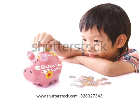 Little boy insert coin into piggy bank with education fund text on white background