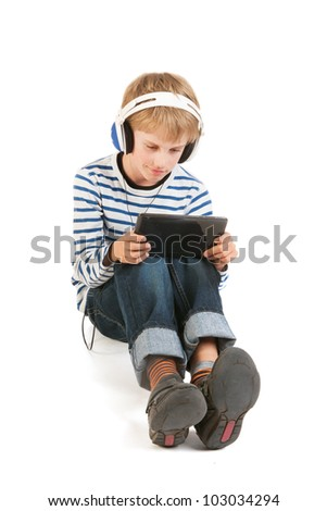 Little boy is concentrated gaming with digital tablet - stock photo