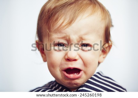 Little boy is crying - selective focus - stock photo