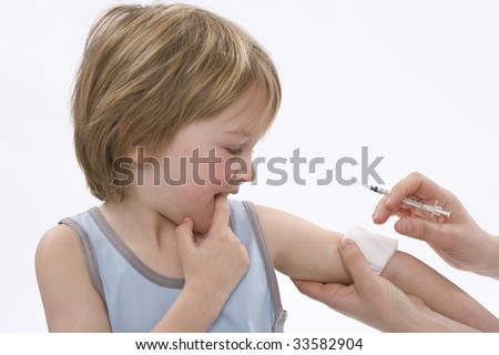 Little boy is getting an injection