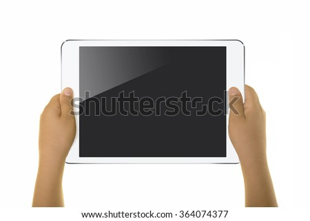 Little boy is holding a digital tablet or smart phone and looks. Isolated on white. Caucasian middle eastern male hand.