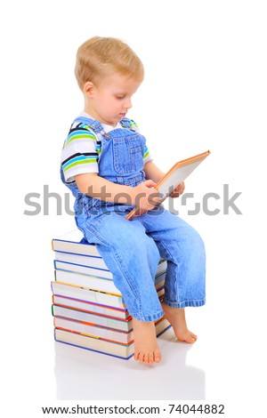 Little boy is learning how to read